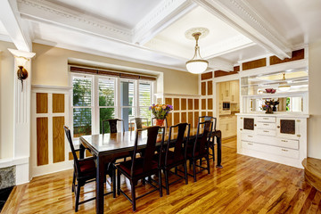 Empressive dining room interior. Luxury house with wood trim