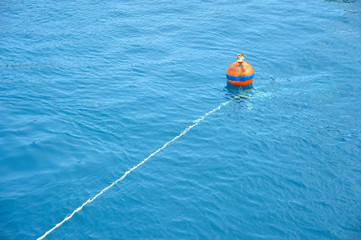 Orange buoy in the sea at dive site