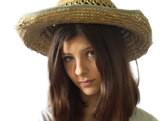 Portrait of girl in a straw hat