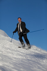 Man in business sute on ski
