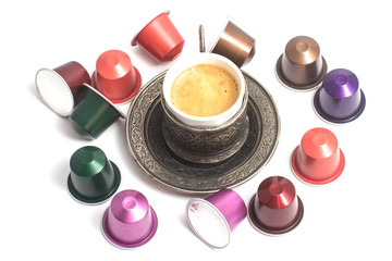 delicious coffee capsules around coffee cup