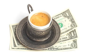 Сup of coffee with 3 dollars tip on white background.