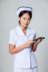 Young Asian nurse with a tablet pc
