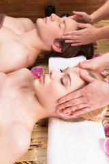 Beautiful couple enjoying head massage.