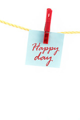 Note colored paper with the word happy day