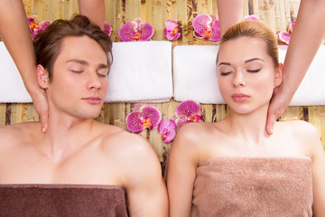 Beautiful couple enjoying head massage.