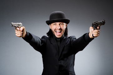 Man wearing vintage hat with gun