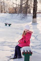 girl on bench in winter park