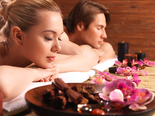 Attractive couple relax at the spa salon.
