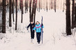 couple with ski in winter forest
