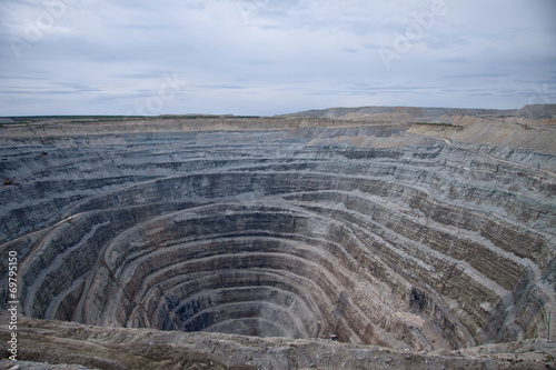 Aerial view to the diamond open mine in Udachny town, Sakha Yaku - 69795150