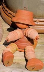 Terracotta flowerpot man © Arena Photo UK