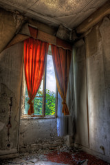 Desolate window in an abandoned house