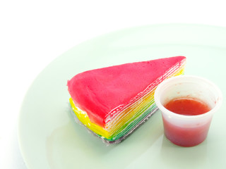 rainbow cake and strawberry souce on white background