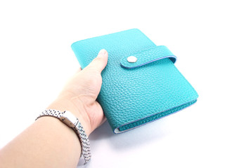 green purse on a white background