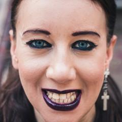 Closeup of a pretty goth girl posing in urban landscape