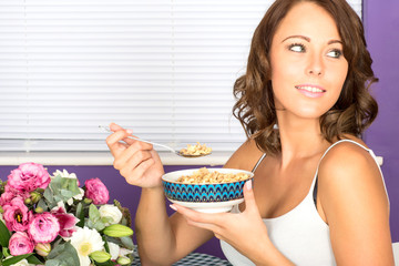 Attractive Young Woman Eating Breakfast Cereal