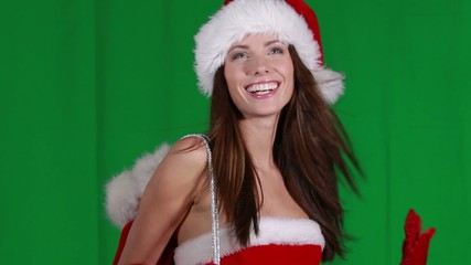 sexy girl wearing santa claus clothes over green screen