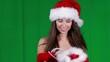 sexy girl wearing santa claus clothes over green screen
