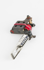 Tattoo machine ( gun ) and needle - Stock Image macro.