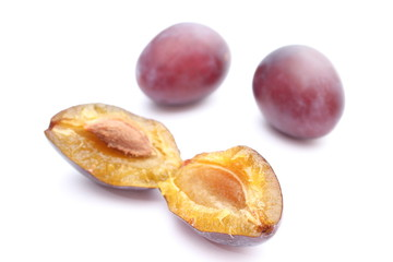 Fresh and natural plums on a white background