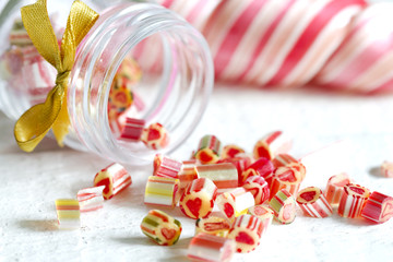 Mixed colorful candy lollipops on white planks
