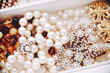 Pearls and vintage jewelry pieces in jewelry box