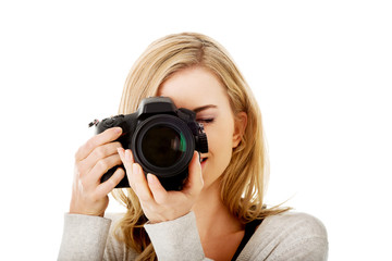 Woman photographer with DSLR