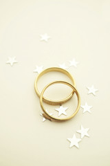 Wedding invitation with gold rings and stars