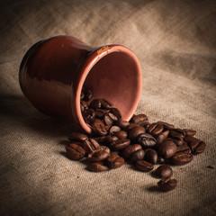 Still-life of coffee grains on fabric