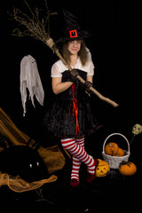 girl witch with a broom and hat for Halloween
