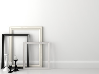 Classic black and white frames on white wall