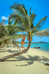 Woman standing on palm at sea background in Koh Samui Maenam
