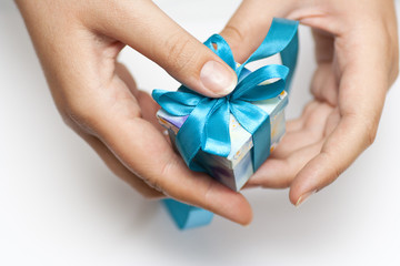 Woman hands holding small gift