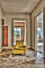 Yellow armchair in an abandoned house
