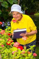 Portrait of pretty senior woman with flowers