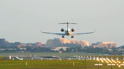 Small Jet is landing on Airport