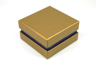 Golden gift box isolated on white