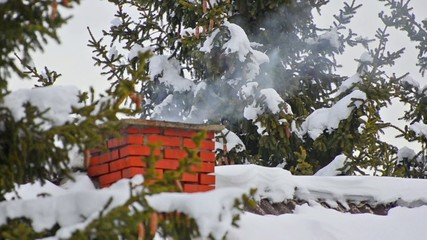 house chimney detail with smoke coming out of it