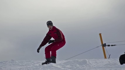 Snowboarder Jumps on skyslope  Stock Video