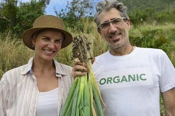Couple of organic farmers showing green onion