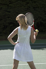 Female tennis player wearing a white linen dress