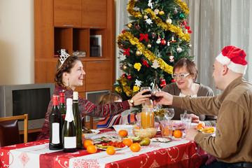 Happy family of three generations celebrating New Year