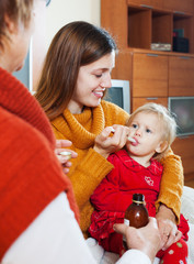 women caring for sick toddler at home