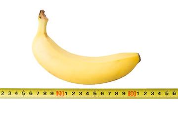 Banana with yard-measure - Stock Image