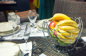 Table with glasses and vase for fruits