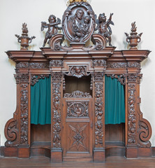 Bruges - The carved confession box in Carmelites church