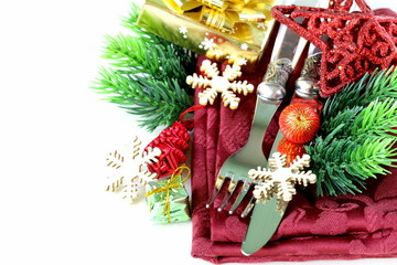 Christmas table setting with festive decorations and snowflakes