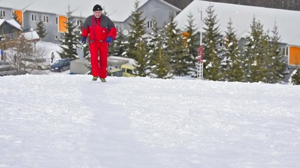 Motion Of Young Sportsman Running Through Snow landscape