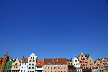 Colourful old buildings with blue sky background in Gdansk